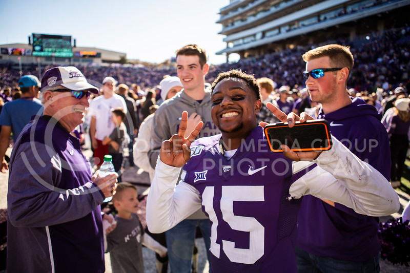 Junior defensive back Walter Neil, Jr. celebrates with teammates and fans after K-State's football team wins their homecoming football game against OU in Bill Snyder Family Stadium on Oct. 26, 2019. The Wildcats upset the No. 5 rated Sooners with a final score of 48-41. (Logan Wassall | Collegian Media Group)