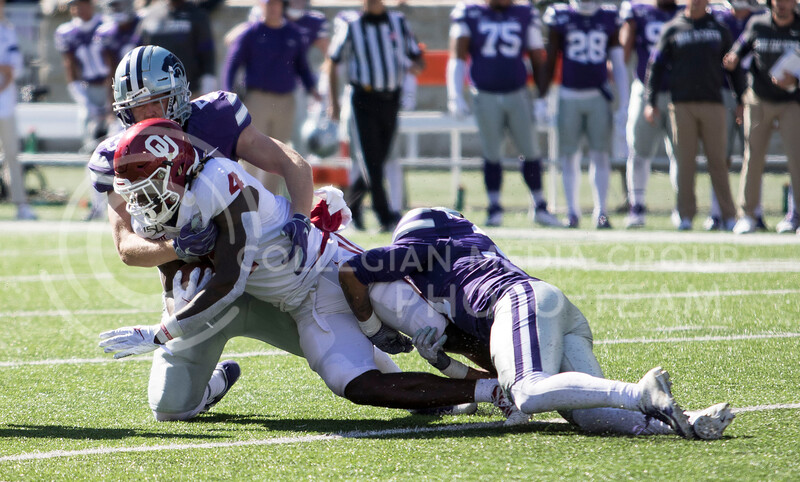 Junior linebacker Cody Fletcher and junior defensive back Jahron McPherson take down Oklahoma's running back during the game against Oklahoma at Bill Snyder Family Stadium on Oct. 26, 2019. (Sabrina Cline | Collegian Media Group)