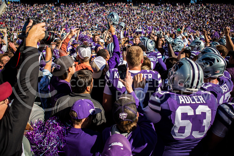 K-State fans rush the field after their football tam wins their homecoming football game against OU in Bill Snyder Family Stadium on Oct. 26, 2019. The Wildcats upset the No. 5 rated Sooners with a final score of 48-41. (Logan Wassall | Collegian Media Group)
