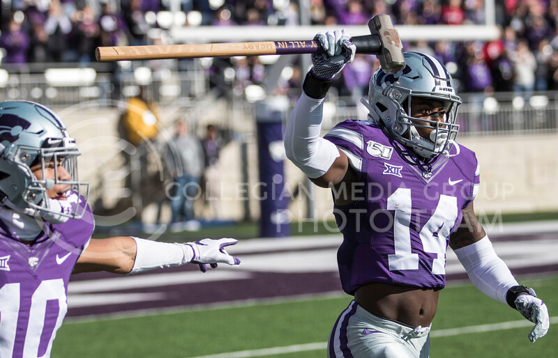 Freshman defensive back Tyrone Lewis runs out of the tunnel holding the sledgehammer the game against Oklahoma at Bill Snyder Family Stadium on Oct. 25, 2019. (Sabrina Cline | Collegian Media Group)