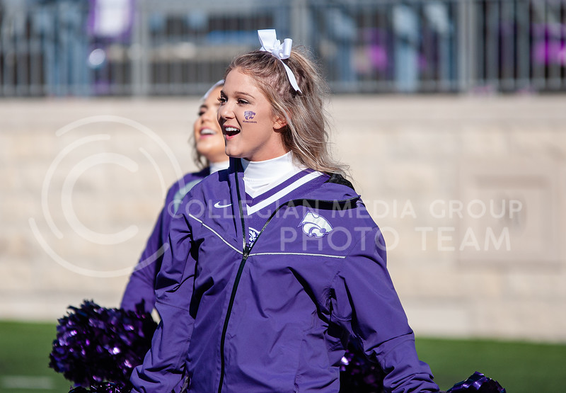 The cheer team on the field moments before K-State's homecoming game against OU on Oct. 26th, 2019. The Wildcats defeated the Sooners 48-41. (Aubrey Bolinger | Collegian Media Group)