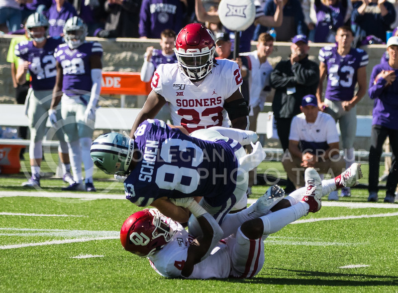 Senior Wide Receiver Dalton Schoen gets tackled after making a successful catch at game against Oklahoma. The Wildcats upset the #5 ranked Sooners 48-41.( Dalton Wainscott I Collegian Media Group )