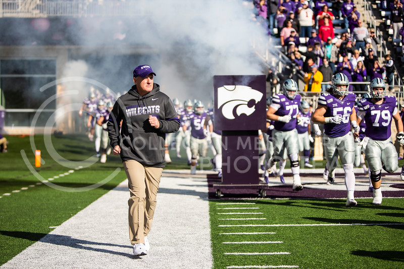 Head coach Chris Klieman runs out onto the field with the rest of K-State's football team before their homecoming football game against OU in Bill Snyder Family Stadium on Oct. 26, 2019. The Wildcats upset the No. 5 rated Sooners with a final score of 48-41. (Logan Wassall | Collegian Media Group)