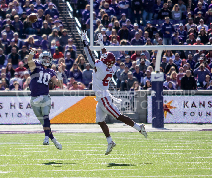 Junior quarterback Skylar Thompson passes the ball down field to senior wide receiver Dalton Schoen during the game against Oklahoma at Bill Snyder Family Stadium on Oct. 26, 2019. (Sabrina Cline | Collegian Media Group)