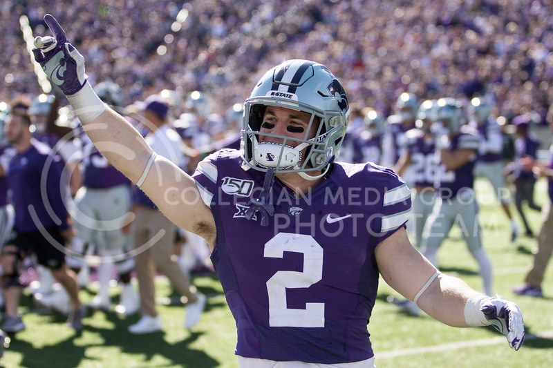 Junior running back Harry Trotter looks to the student section to celebrate the win over number five ranked Oklahoma during the game against Oklahoma at Bill Snyder Family Stadium on Oct. 26, 2019. (Sabrina Cline | Collegian Media Group)