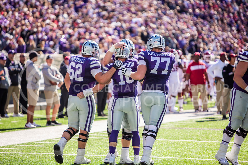 Junior quarterback Skylar Thompson celebrates with his teammates after running in a touchdown during K-State's homecoming football game against OU in Bill Snyder Family Stadium on Oct. 26, 2019. The Wildcats upset the No. 5 rated Sooners with a final score of 48-41. (Logan Wassall | Collegian Media Group)