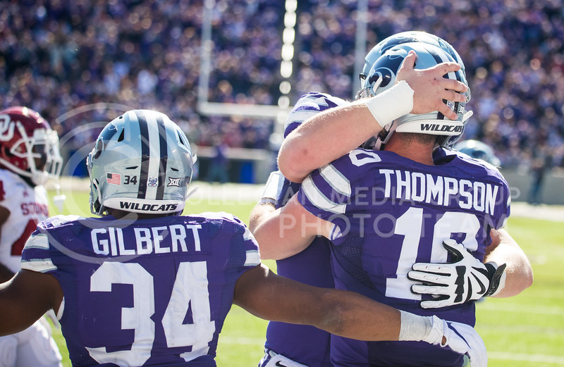 Teammates hug and celebrate with Junior Quarterback Skylar Thompson after he scores a touchdown at game against Oklahoma. The Wildcats upset the #5 ranked Sooners 48-41.( Dalton Wainscott I Collegian Media Group )