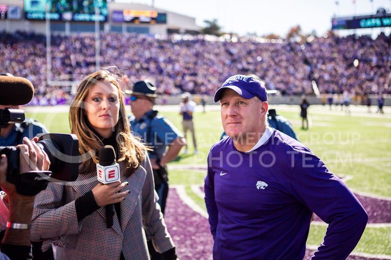 Head coach Chris Klieman waits to be interviewed on the field after K-State's football team wins their homecoming football game against OU in Bill Snyder Family Stadium on Oct. 26, 2019. The Wildcats upset the No. 5 rated Sooners with a final score of 48-41. (Logan Wassall | Collegian Media Group)