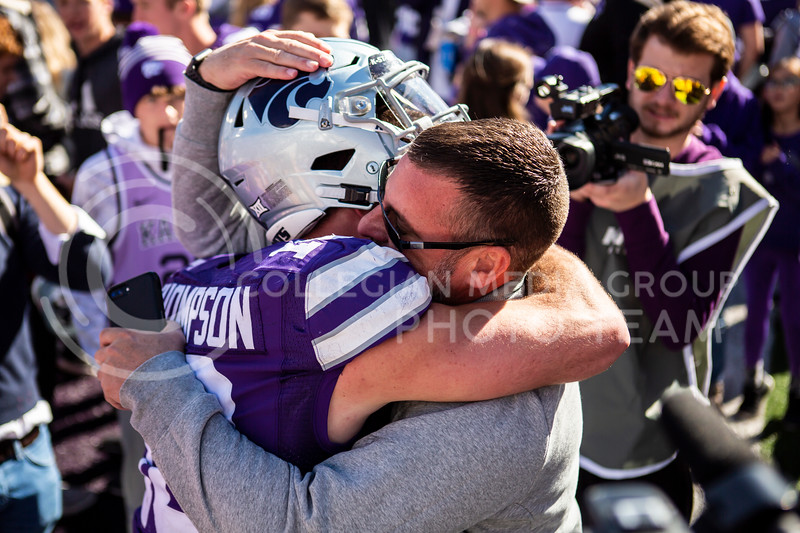 Junior quarterback Skylar Thompson embraces a hug from his dad after K-State's football team wins their homecoming football game against OU in Bill Snyder Family Stadium on Oct. 26, 2019. The Wildcats upset the No. 5 rated Sooners with a final score of 48-41. (Logan Wassall | Collegian Media Group)