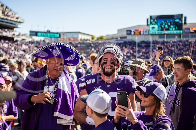 Junior quarterback Skylar Thompson celebrates with fans and teammates after K-State's football team wins their homecoming football game against OU in Bill Snyder Family Stadium on Oct. 26, 2019. The Wildcats upset the No. 5 rated Sooners with a final score of 48-41. (Logan Wassall | Collegian Media Group)