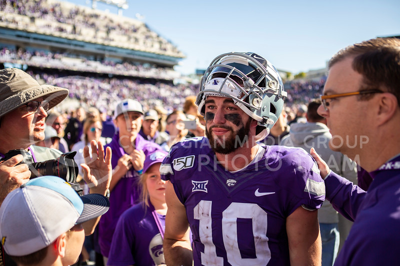 An emotional Skylar Thompson celebrates with fans and teammates after K-State's football team wins their homecoming football game against OU in Bill Snyder Family Stadium on Oct. 26, 2019. The Wildcats upset the No. 5 rated Sooners with a final score of 48-41. (Logan Wassall | Collegian Media Group)