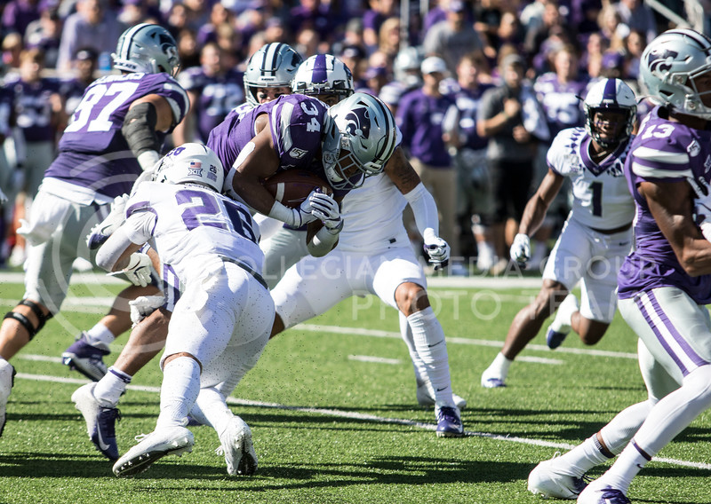 Senior running back James Gilbert rushes the ball downfield during the game against TCU on Oct. 19, 2019 at Bill Snyder Family Stadium. (Sabrina Cline | Collegian Media Group)