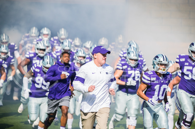 Head Coach Chris Klienman runs out with players at game against the TCU Horned Frogs. The Wildcats beat TCU 24-17. ( Dalton Wainscott I Collegian Media Group )