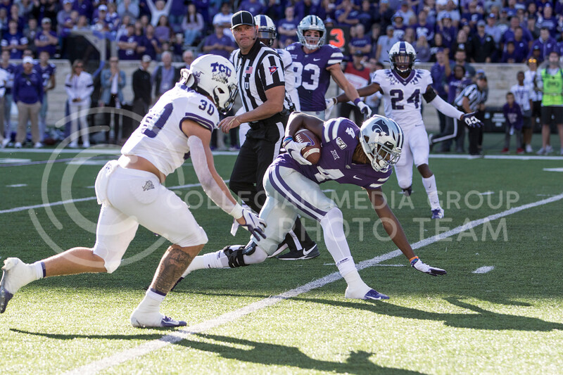 Redshirt freshman Malik Knowles receives the ball and rushes down field during the game against TCU on Oct. 19, 2019 at Bill Snyder Family Stadium. (Sabrina Cline   Collegian Media Group)