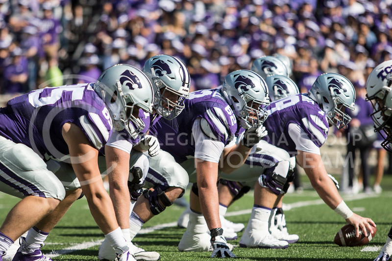 The offensive line gets set for the next play during the game against TCU on Oct. 19, 2019 at Bill Snyder Family Stadium. (Sabrina Cline | Collegian Media Group)