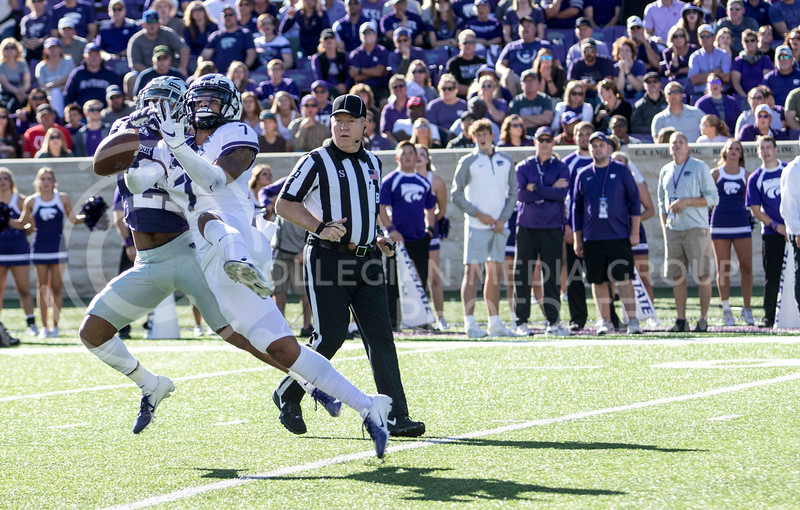 Junior wide receiver Wykeen Gill reaches up for the ball during the game against TCU on Oct. 19, 2019 at Bill Snyder Family Stadium. (Sabrina Cline | Collegian Media Group)