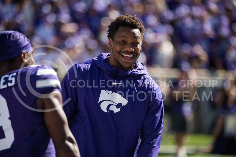Senior Defesnive Back Daron Bowles laughs with teamate prior to game against the TCU Horned Frogs. The Wildcats beat TCU 24-17. ( Dalton Wainscott I Collegian Media Group )