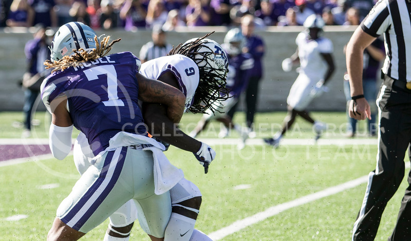 Senior defensive back Kevion McGee makes a big tackle during the game against TCU on Oct. 19, 2019 at Bill Snyder Family Stadium. (Sabrina Cline | Collegian Media Group)