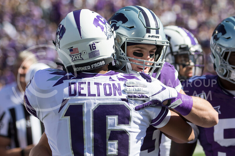Senior wide receiver Dalton Schoen embraces former teammate and quarterback of TCU Alex Delton before the coin toss at the game against TCU on Oct. 19, 2019 at Bill Snyder Family Stadium. (Sabrina Cline   Collegian Media Group)