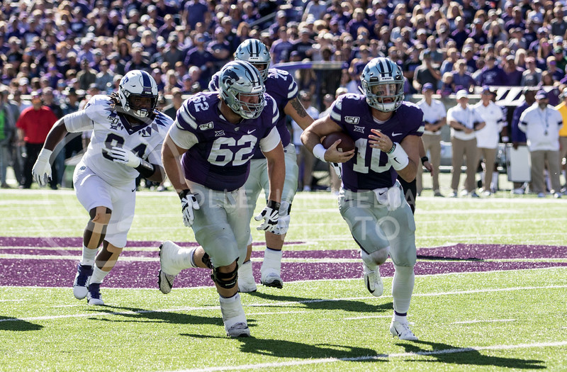Junior quarterback Skylar Thompson rushes the ball for the first down during the game against TCU on Oct. 19, 2019 at Bill Snyder Family Stadium. (Sabrina Cline | Collegian Media Group)