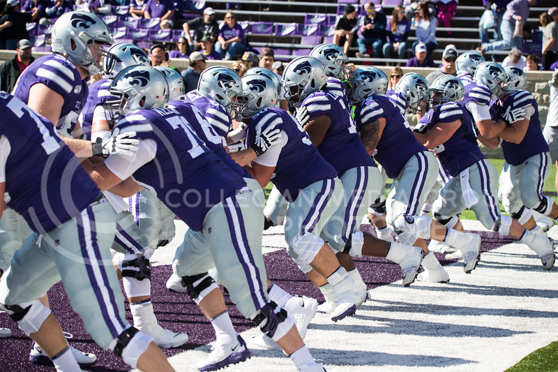 K-state defense and offense do warmups drills prior to the start of game against the TCU Horned Frogs. The Wildcats beat TCU 24-17. (Dalton Wainscott I Collegian Media )