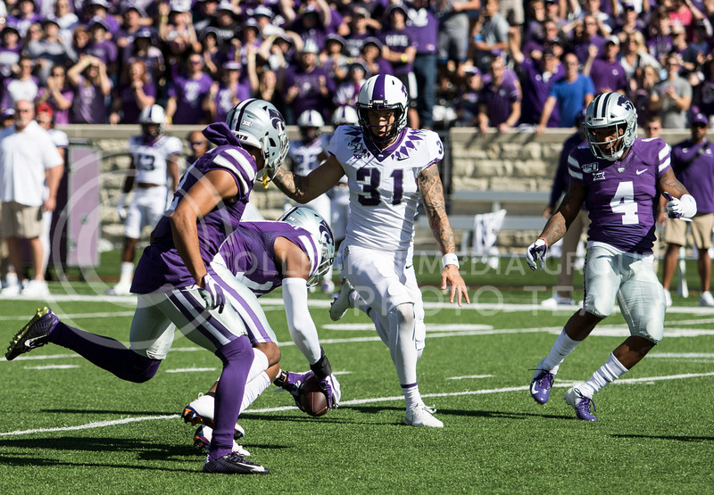 Junior defensive back Jonathan Alexander picks up the ball after the punt was blocked during the game against TCU on Oct. 19, 2019 at Bill Snyder Family Stadium. (Sabrina Cline   Collegian Media Group)