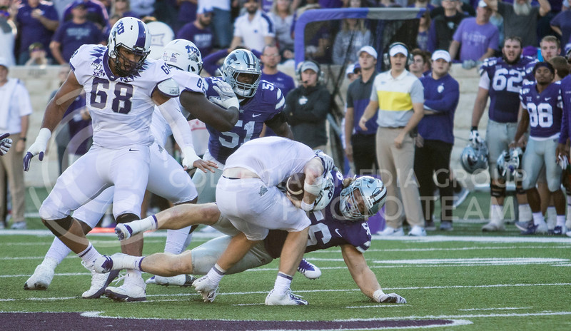 Sophomore defensive end Wyatt Hubert tackles the TCU quarterback during the game against TCU on Oct. 19, 2019 at Bill Snyder Family Stadium. (Sabrina Cline   Collegian Media Group)