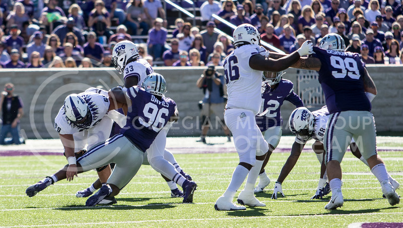 Senior defensive tackle Joe Davies makes a tackle during the game against TCU on Oct. 19, 2019 at Bill Snyder Family Stadium. (Sabrina Cline | Collegian Media Group)