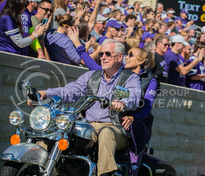 President Richard Meyers and his wife Mary Jo Myers ride into the stadium on a Harley for Harley Davidson day at game against the TCU Horned Frogs. The Wildcats beat TCU 24-17. ( Dalton Wainscott I Collegian Media Group )