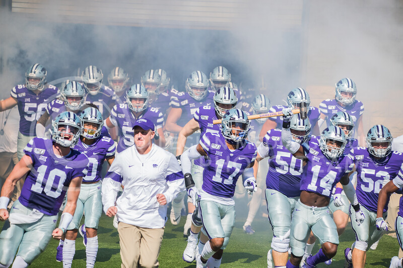 Head Coach Klienman runs out of tunnel with players at game against the TCU Horned Frogs. The Wildcats beat TCU 24-17. ( Dalton Wainscott I Collegian Media Group )