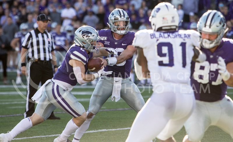 Junior quarterback Skylar Thompson hands off the ball to junior running back Harry Trotter during the game against TCU on Oct. 19, 2019 at Bill Snyder Family Stadium. (Sabrina Cline   Collegian Media Group)