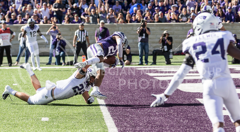 Junior wide receiver Wykeen Gill falls into the end zone for a touchdown during the game against TCU on Oct. 19, 2019 at Bill Snyder Family Stadium. (Sabrina Cline | Collegian Media Group)