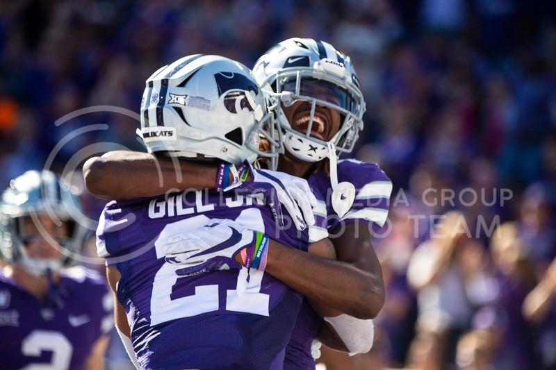 Junior Wide Reciever Wykeen Gill hugged by teammate after scoring touchdown at game against TCU. The Wildcats beat TCU 24-17. ( Dalton Wainscott I Collegian Media Group )