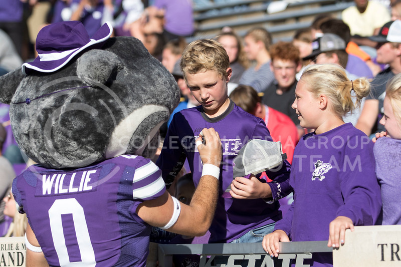 Willie the Wildcat signs a fans shirt during the game against TCU on Oct. 19, 2019 at Bill Snyder Family Stadium. (Sabrina Cline | Collegian Media Group)