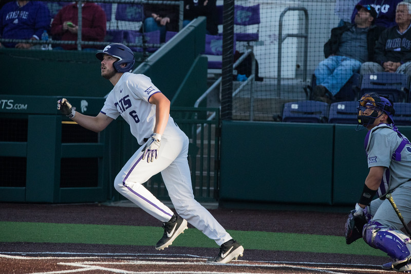 Sophomore Terrence Spurlin looks up to ball he just hit at game against TCU, the Wildcats won 7-4 at Tointon Stadium in Manhattan. The baseball team held a fundraiser along with the game, in coordination with the Silver Key Sophomore Honorary. (Dalton Wainscott I Collegian Media Group)
