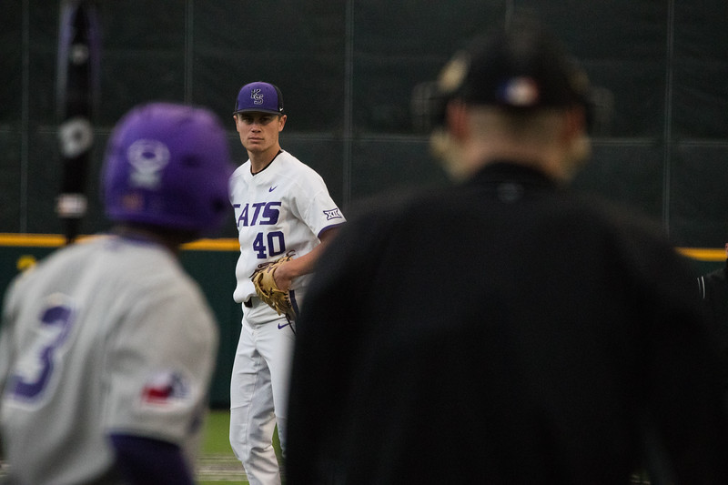 Freshmen Griffin Hassall looks towards catcher at game against TCU, the Wildcats won 7-4 at Tointon Stadium in Manhattan. The baseball team held a fundraiser along with the game, in coordination with the Silver Key Sophomore Honorary. (Dalton Wainscott I Collegian Media Group)