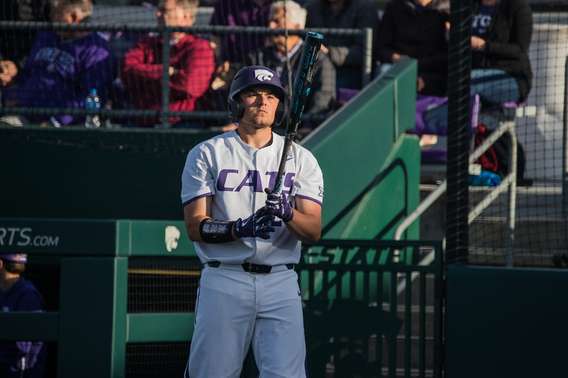 Freshmen Dylan Phillips looks at before getting ready to swing at game against TCU, the Wildcats won 7-4 at Tointon Stadium in Manhattan. The baseball team held a fundraiser along with the game, in coordination with the Silver Key Sophomore Honorary. (Dalton Wainscott I Collegian Media Group)