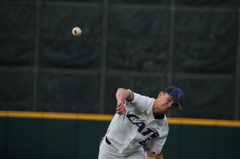 Freshmen Griffin Hassall throws first pitch at game against TCU, the Wildcats won 7-4 at Tointon Stadium in Manhattan. The baseball team held a fundraiser along with the game, in coordination with the Silver Key Sophomore Honorary. (Dalton Wainscott I Collegian Media Group)