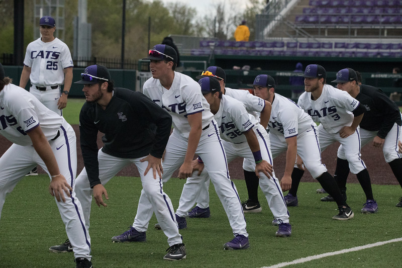 KSU Baseball team prepares for running drill before game against TCU, the Wildcats won 7-4 at Tointon Stadium in Manhattan. The baseball team held a fundraiser along with the game, in coordination with the Silver Key Sophomore Honorary. (Dalton Wainscott I Collegian Media Group)