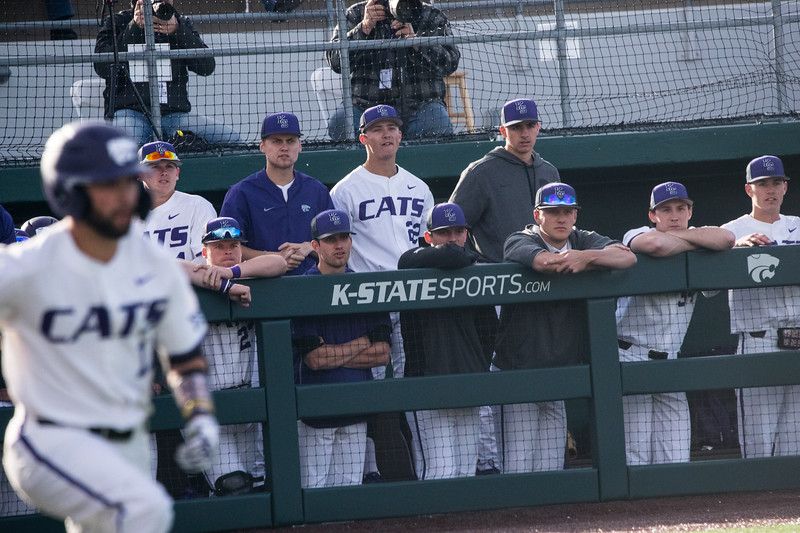 KSU dugout watches as teamate Sophomore Zach Kokoska runs to first at game against TCU, the Wildcats won 7-4 at Tointon Stadium in Manhattan. The baseball team held a fundraiser along with the game, in coordination with the Silver Key Sophomore Honorary. (Dalton Wainscott I Collegian Media Group)