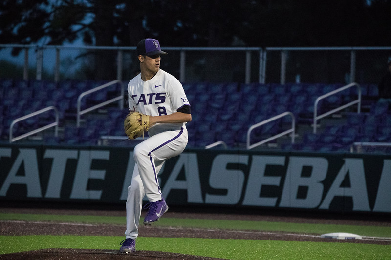 Pitcher Sophomore Andrew Stratman mid warmup pitch at game against TCU, the Wildcats won 7-4 at Tointon Stadium in Manhattan. The baseball team held a fundraiser along with the game, in coordination with the Silver Key Sophomore Honorary. (Dalton Wainscott I Collegian Media Group)