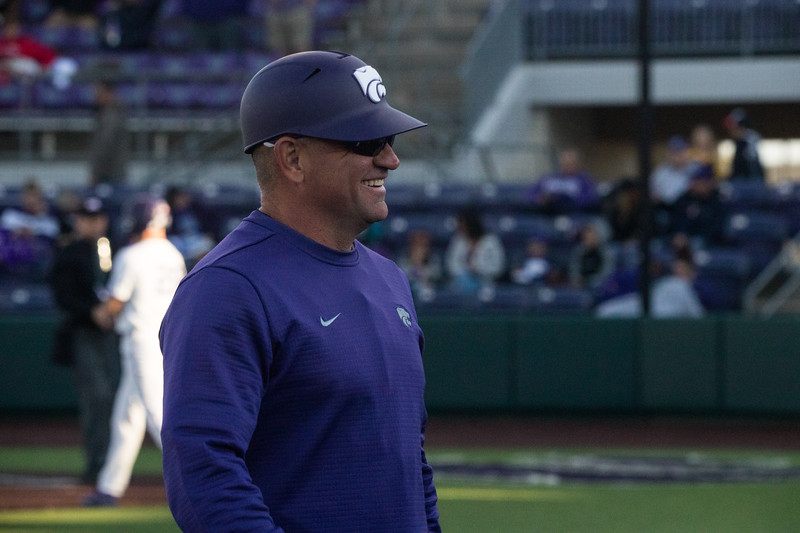 Head Coach Pete Hughes smiles at family at game against TCU, the Wildcats won 7-4 at Tointon Stadium in Manhattan. The baseball team held a fundraiser along with the game, in coordination with the Silver Key Sophomore Honorary. (Dalton Wainscott I Collegian Media Group)
