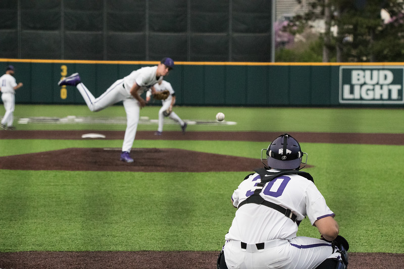 Freshmen Griffin Hassall throws warmup pitch to Junior Chris Ceballos at game against TCU, the Wildcats won 7-4 at Tointon Stadium in Manhattan. The baseball team held a fundraiser along with the game, in coordination with the Silver Key Sophomore Honorary. (Dalton Wainscott I Collegian Media Group)