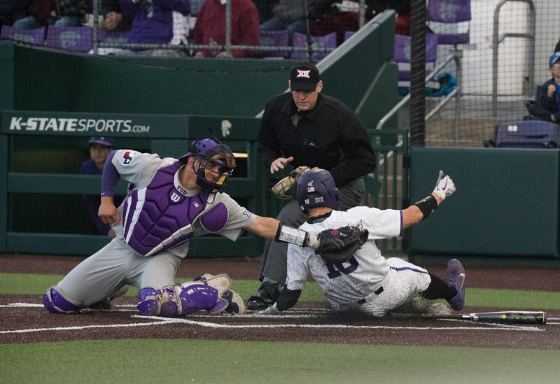 Junior Will Brennan slides into homeplate at  game against TCU, the Wildcats won 7-4 at Tointon Stadium in Manhattan. The baseball team held a fundraiser along with the game, in coordination with the Silver Key Sophomore Honorary. (Dalton Wainscott I Collegian Media Group)