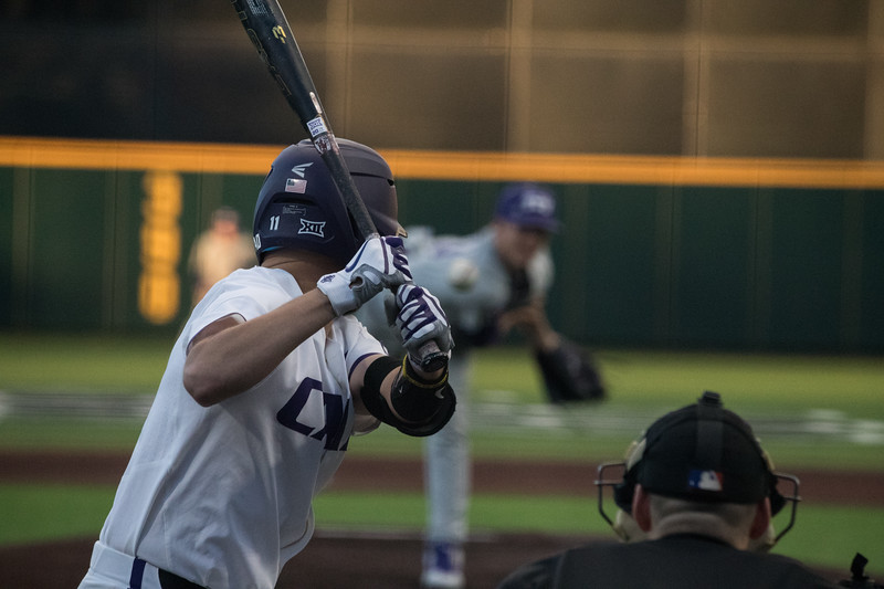 Senior Thomas Hughes prepares to swing at game against TCU, the Wildcats won 7-4 at Tointon Stadium in Manhattan. The baseball team held a fundraiser along with the game, in coordination with the Silver Key Sophomore Honorary. (Dalton Wainscott I Collegian Media Group)