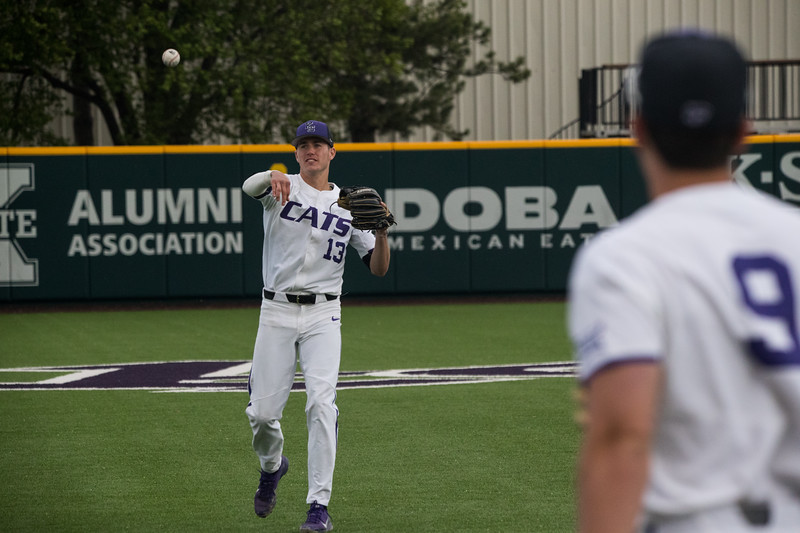 Junior Caleb Littlejim throws baseball to teamate Freshmen Jeffrey Boggess before game against TCU, the Wildcats won 7-4 at Tointon Stadium in Manhattan. The baseball team held a fundraiser along with the game, in coordination with the Silver Key Sophomore Honorary. (Dalton Wainscott I Collegian Media Group)