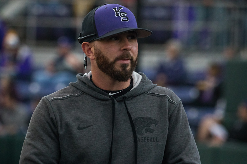 Graduate Manager Josh Ake looks towards KSU dugout at game against TCU, the Wildcats won 7-4 at Tointon Stadium in Manhattan. The baseball team held a fundraiser along with the game, in coordination with the Silver Key Sophomore Honorary. (Dalton Wainscott I Collegian Media Group)