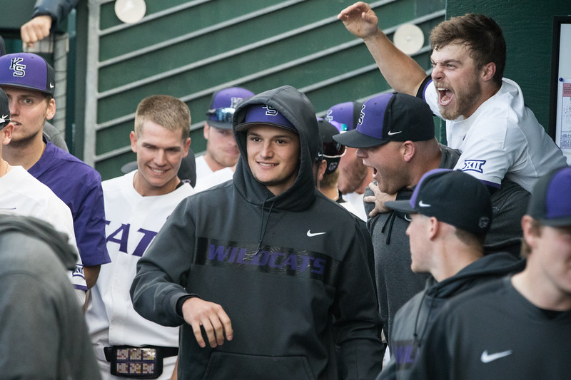 KSU dugout celebrates after successful run at game against TCU, the Wildcats won 7-4 at Tointon Stadium in Manhattan. The baseball team held a fundraiser along with the game, in coordination with the Silver Key Sophomore Honorary. (Dalton Wainscott I Collegian Media Group)