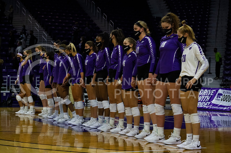The wildcats volleyball team line up for the national anthem before the game at Bramledge Coliseum on October 17th 2020. The wildcats lost to the #1 ranked Texas by a score of 3-0 in the second game of the series. (Dalton Wainscott I Collegian Media Group).