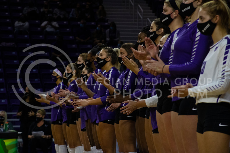 K-State volleyball players clap as the opposing teams players are introduced at the game at Bramledge Coliseum on October 17th 2020. The wildcats lost to the #1 ranked Texas by a score of 3-0 in the second game of the series. (Dalton Wainscott I Collegian Media Group).
